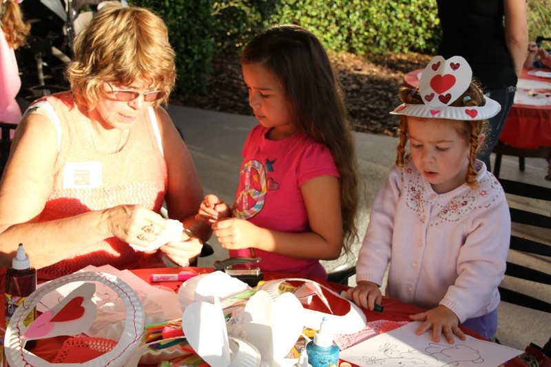 Liz Estes Helping Children to make Valentines Crafts at the Creativity Extravaganza!